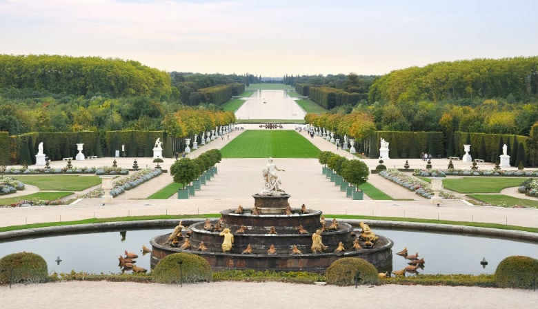 The Versailles Palace gardens with fountains
