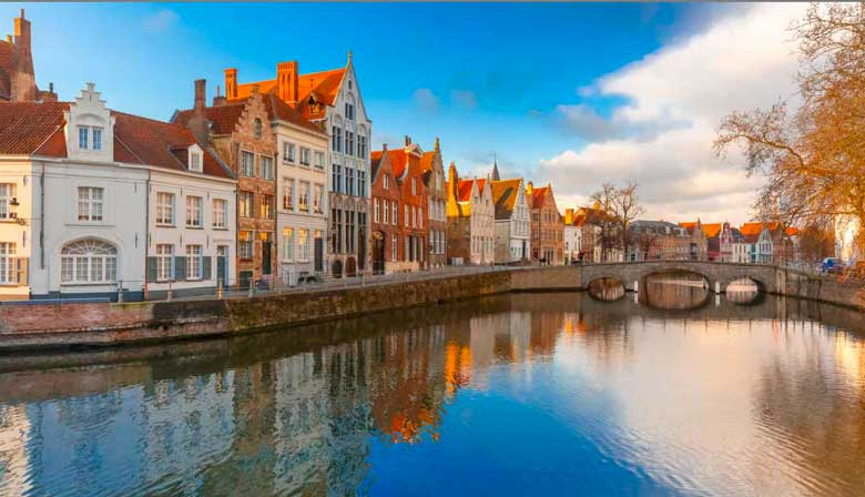 Canal along the colored houses in Bruges