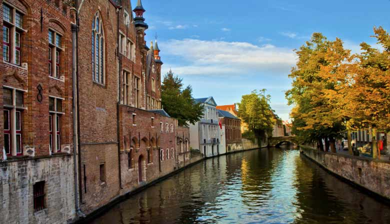 Quiet cruise on the canal of Bruges