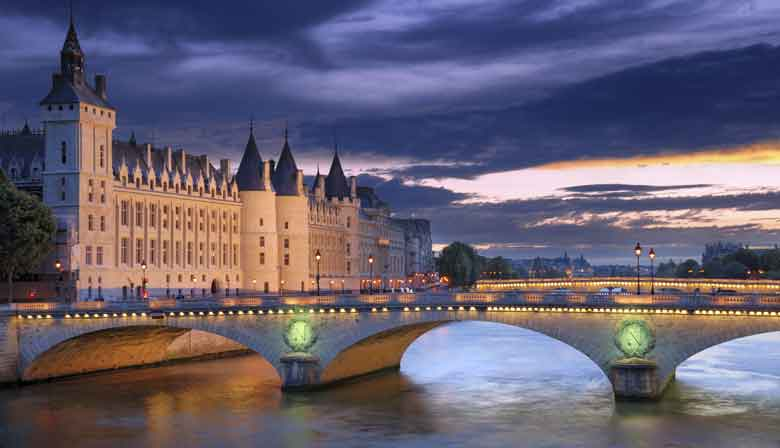 Conciergerie view by night from the Seine river