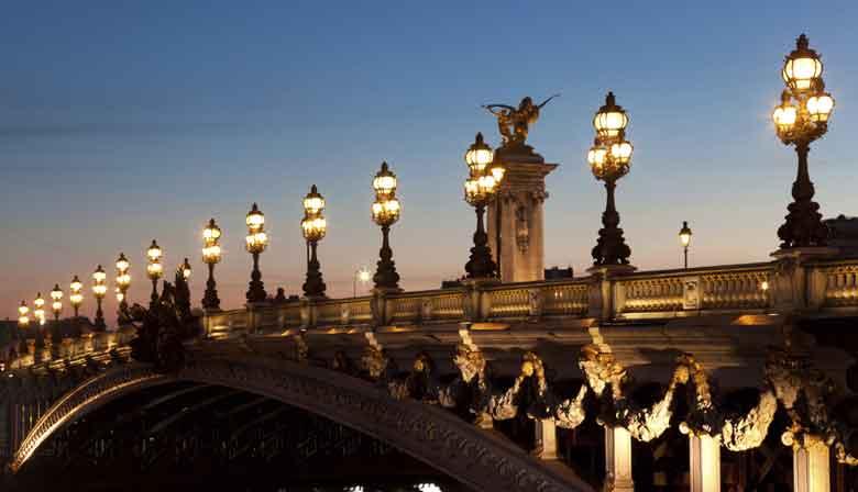 Paris bridge illuminated