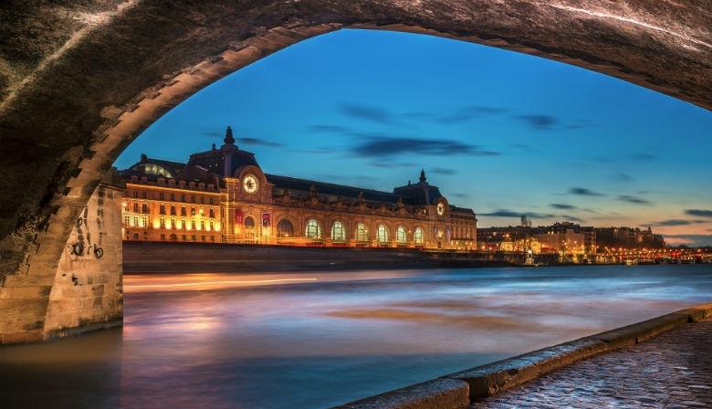 Illuminated bridge over the Seine river in Paris