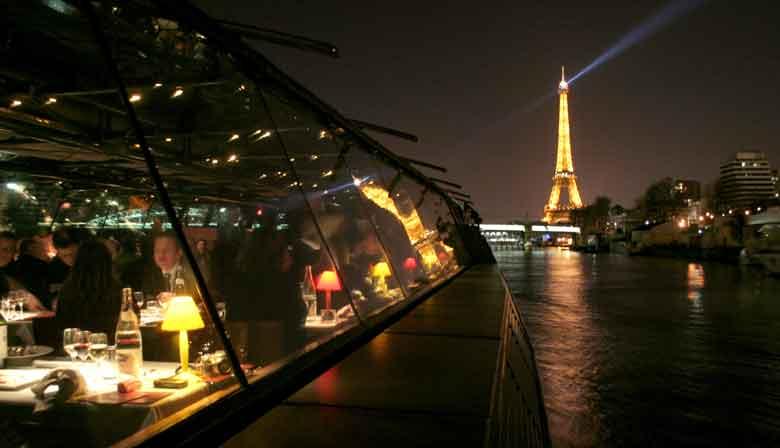 Dinner cruise with the illuminated Eiffel Tower on the horizon
