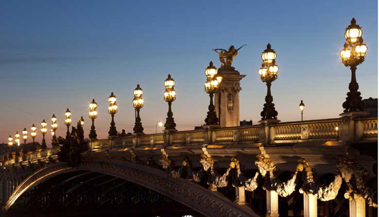 Seine cruise at the sunset through Pont Alexandre III