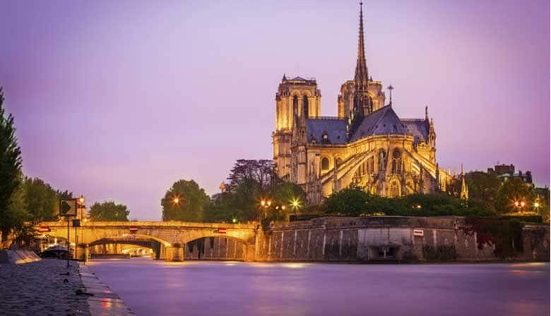 View of the Notre Dame from a boat at night