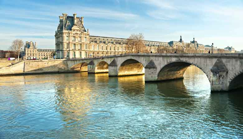 View of the Louvre in Paris from the Seine river