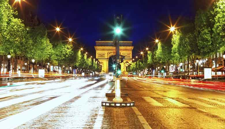 The Champs Elysees Avenue and the Arc of Triumph illuminated