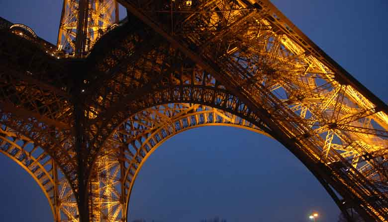 Eiffel Tower illuminated on a Paris by night tour