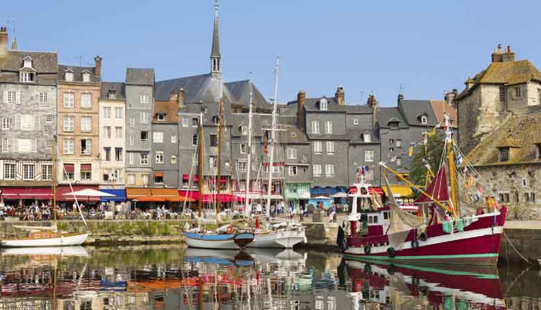 Enjoy the village of Honfleur and its lovely harbour