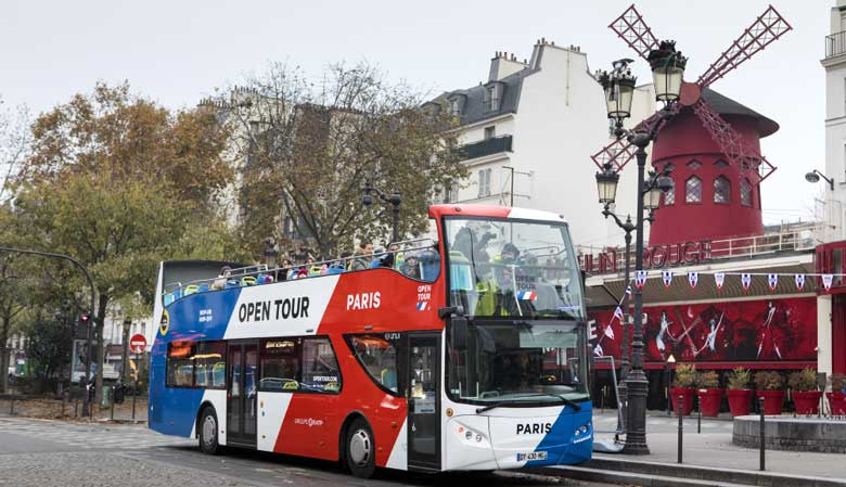 The Opentour bus in front of the Moulin Rouge