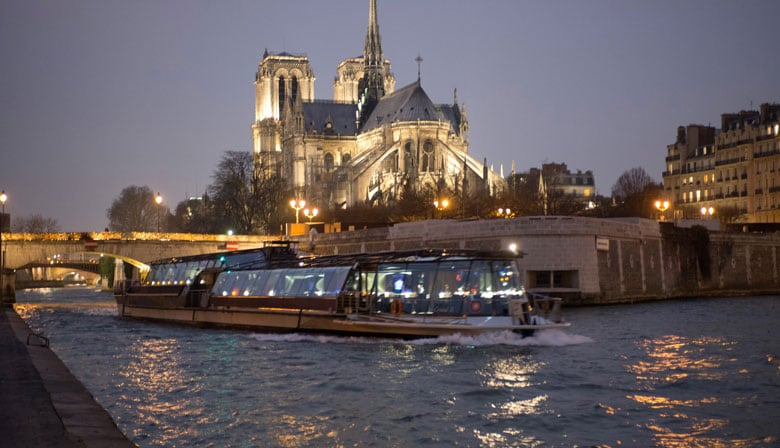 Boat on the river seine at night