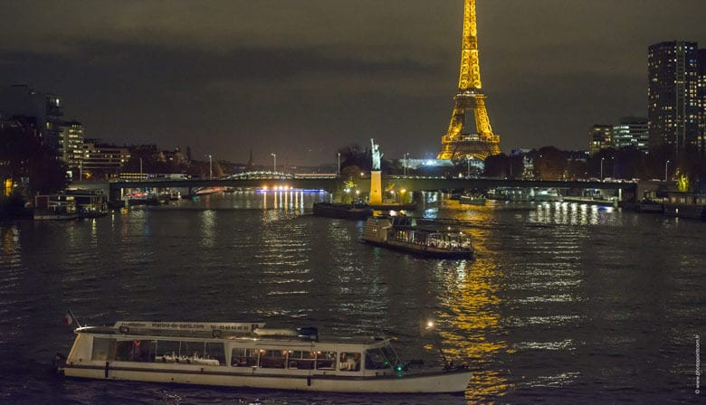 Enjoy the view of the glittering Eiffel Tower
