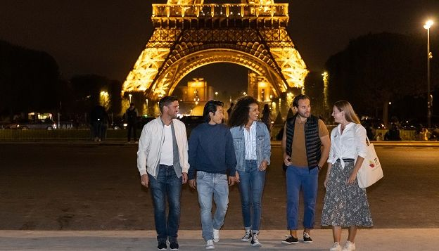 Eiffel Tower by night with friends